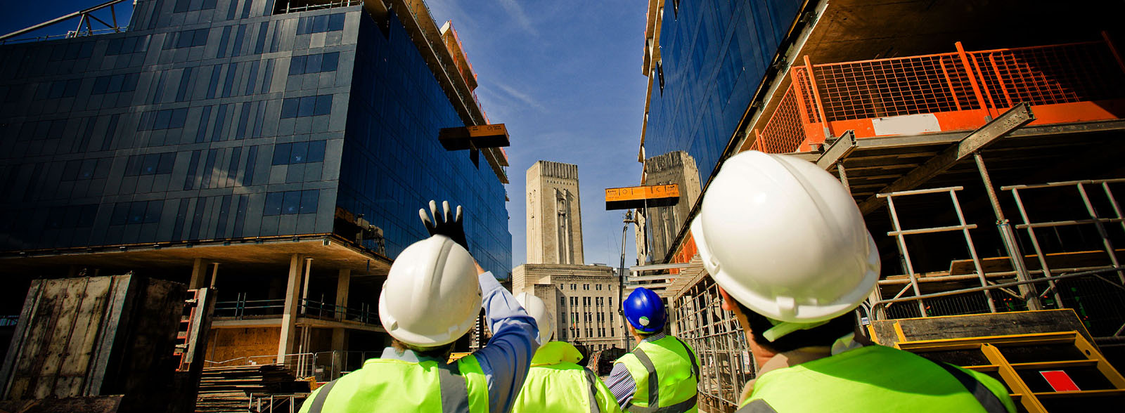 Workers reviewing a construction project with outside louvers
